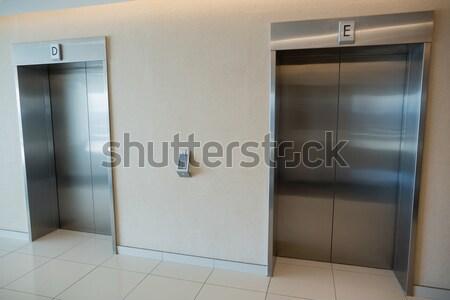 Two elevator doors in lobby of office building Stock photo © wavebreak_media