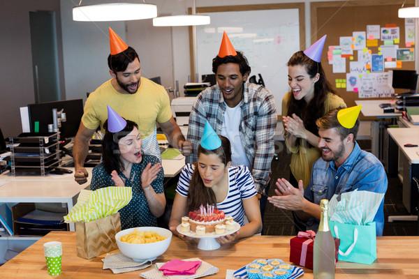 Creative business team celebrating colleagues birthday Stock photo © wavebreak_media