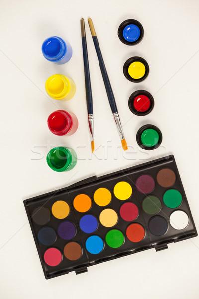 Paint brushes, watercolor paints and watercolor palette Stock photo © wavebreak_media