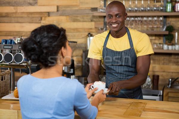 Portrait of barista serving coffee to customer in cafe Stock photo © wavebreak_media