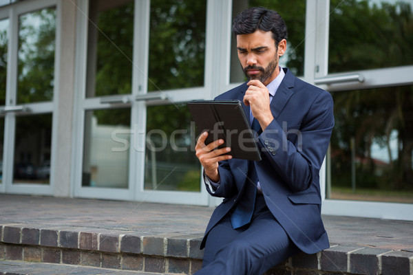 Businessman using digital tablet Stock photo © wavebreak_media