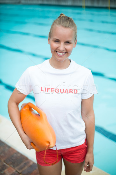 Portrait of lifeguard holding rescue can at poolside Stock photo © wavebreak_media