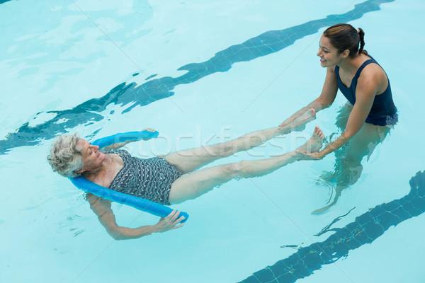Female coach helping senior woman in swimming pool Stock photo © wavebreak_media