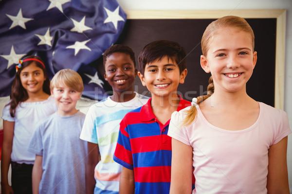Composite image of smiling little school kids in school corridor Stock photo © wavebreak_media