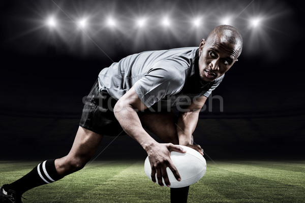 Composite image of determined sportsman looking away while playi Stock photo © wavebreak_media