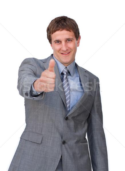 Positive businessman with a thumb up Stock photo © wavebreak_media