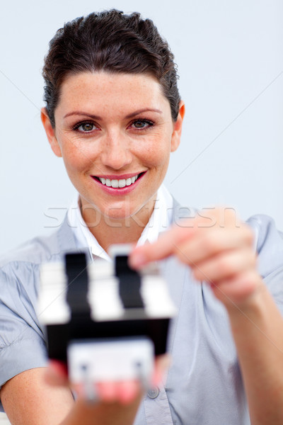 Positive businesswoman consulting a business card holder Stock photo © wavebreak_media