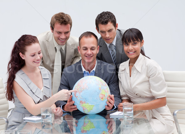 Business team holding a terrestrial globe. Worldwide business Stock photo © wavebreak_media