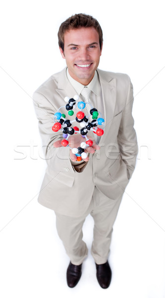 Self-assured businessman holding a molecule Stock photo © wavebreak_media