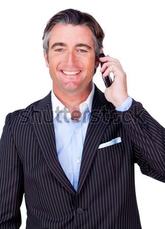 Charyzmatyczny atrakcyjny biznesmen telefonu komórkowego biały działalności Zdjęcia stock © wavebreak_media