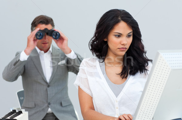 Stock photo: Ambitious businessman looking her colleague's computer through b