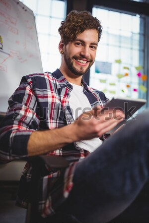 Smiling businessman holding a business card holder Stock photo © wavebreak_media