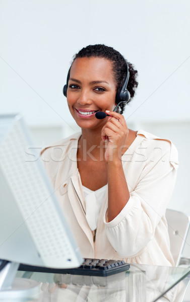 Encantador empresária fone trabalhando computador escritório Foto stock © wavebreak_media