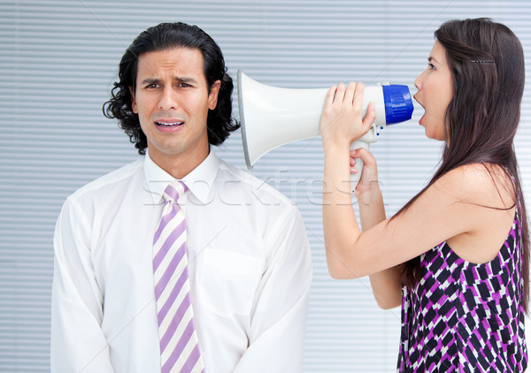 Angry businesswoman yelling through a megaphone Stock photo © wavebreak_media