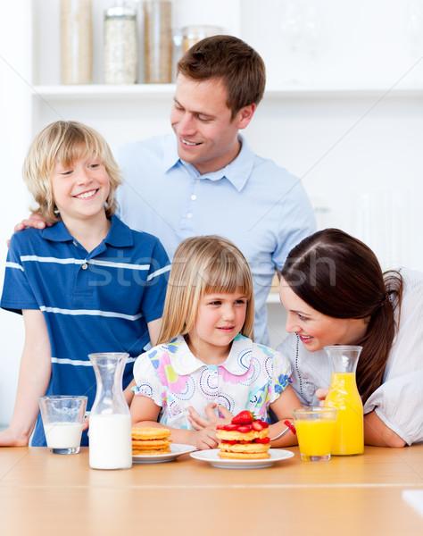 Jolly family eating breakfast in the kitchen Stock photo © wavebreak_media