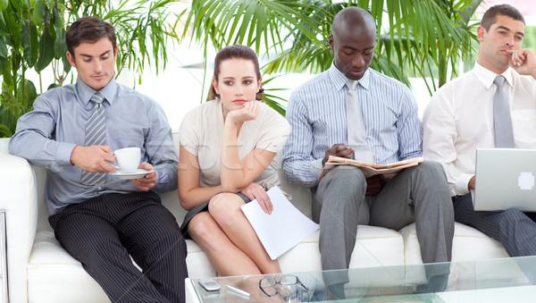 退屈 ビジネスの方々  座って ソファ 待って インタビュー ストックフォト © wavebreak_media