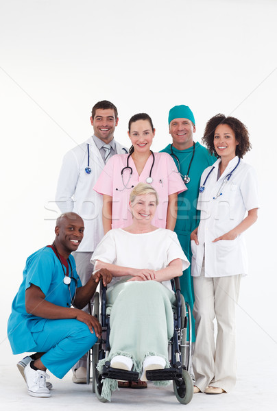 Doctors with a patient in a wheel chair Stock photo © wavebreak_media