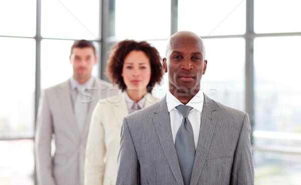 Ernstig zakenman leidend collega's kantoor glimlach Stockfoto © wavebreak_media