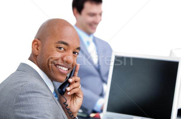 Heureux affaires téléphone collègue travail ordinateur Photo stock © wavebreak_media