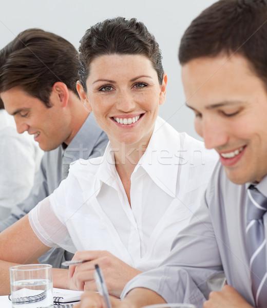 Séduisant femme d'affaires réunion équipe regarder caméra Photo stock © wavebreak_media