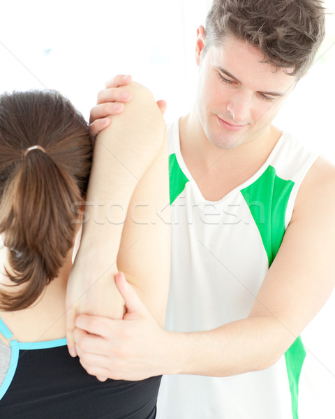 Young physical therapist checking a woman's shoulder Stock photo © wavebreak_media