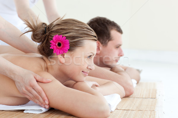Jolly young couple receiving a back massage Stock photo © wavebreak_media