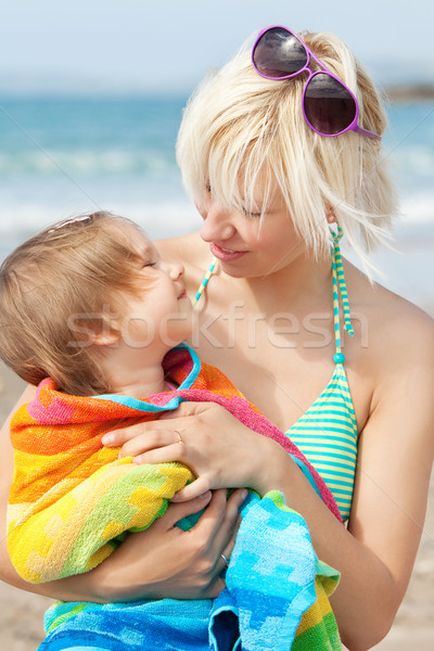 A portrait of a smiling girl in a towel in the arms of her mothe Stock photo © wavebreak_media