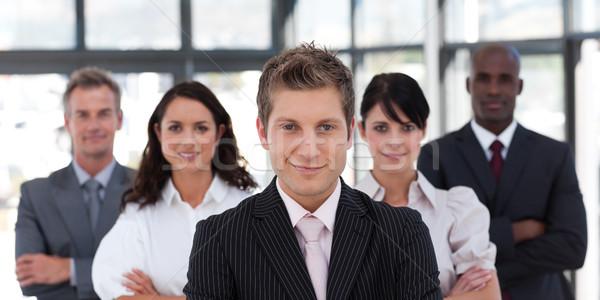 Equipe de negócios olhando câmera escritório negócio mulheres Foto stock © wavebreak_media