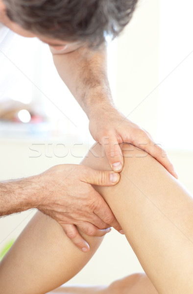 Close-up of a young physical therapist giving a leg massage Stock photo © wavebreak_media