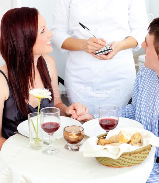 Atractivo Pareja cena restaurante camarero toma Foto stock © wavebreak_media