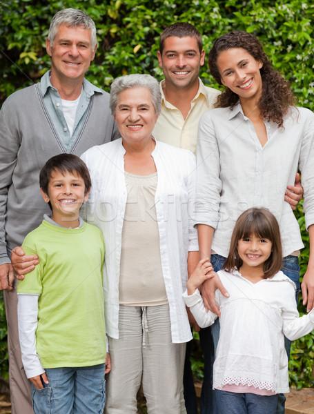 Portré boldog család néz kamera kert család Stock fotó © wavebreak_media