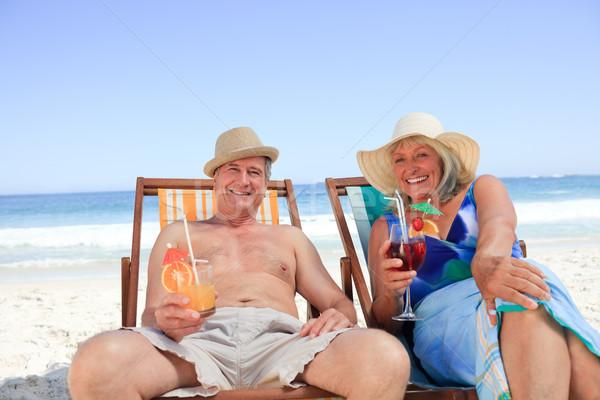 зрелый пару сидят палуба стульев воды Сток-фото © wavebreak_media