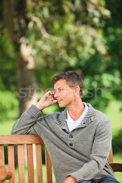 Man phoning on the bench Stock photo © wavebreak_media