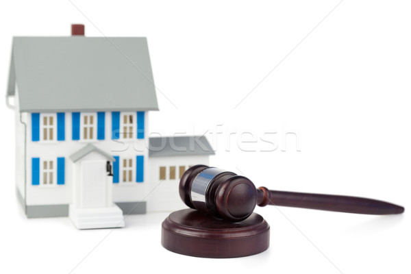 Grey toy house model and brown gavel against a white background Stock photo © wavebreak_media