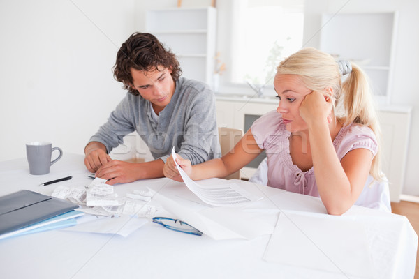 Stressed couple doing accounts in their living room Stock photo © wavebreak_media