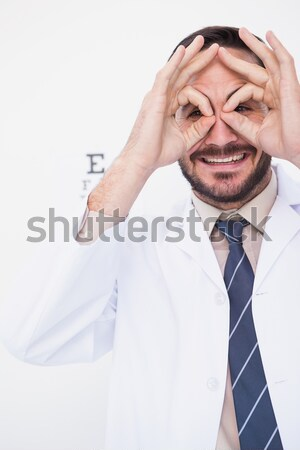 Sad businessman with his hands on his temples against a white background Stock photo © wavebreak_media