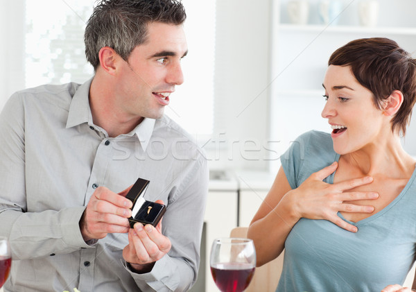 Man proposing to his girlfriend in a dining room Stock photo © wavebreak_media