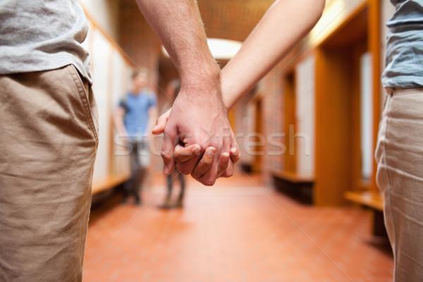 Couple holding hands in a corridor Stock photo © wavebreak_media