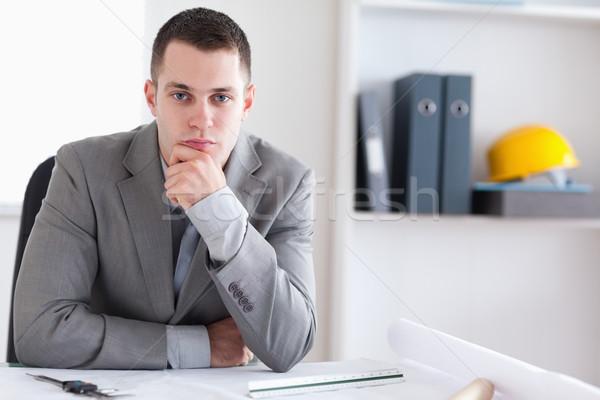 Architect sitting behind a table and thinking Stock photo © wavebreak_media