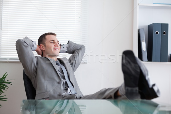 Young smiling businessman taking a rest Stock photo © wavebreak_media