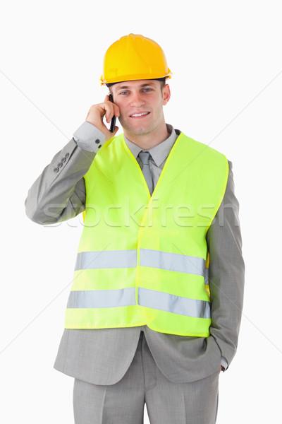 Portré jóképű építész készít telefonbeszélgetés fehér Stock fotó © wavebreak_media