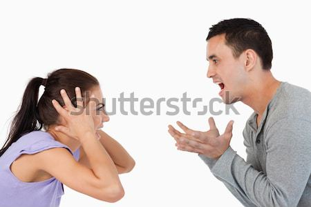 Stock photo: Young couple yelling at each other against a white background