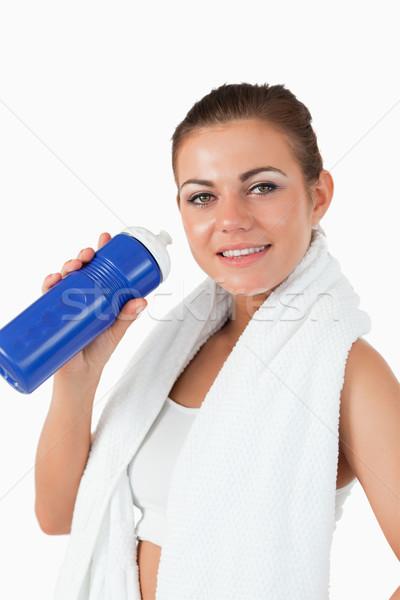 Donna sorridente bottiglia allenamento bianco salute sfondo Foto d'archivio © wavebreak_media
