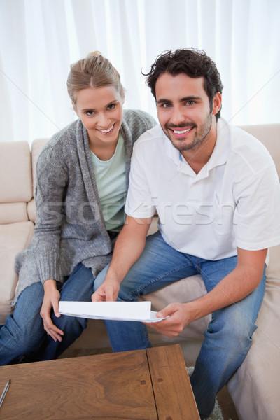 Portré boldog pár olvas levél nappali Stock fotó © wavebreak_media