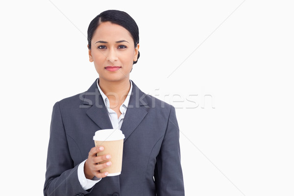 Close up of saleswoman with paper cup against a white background Stock photo © wavebreak_media