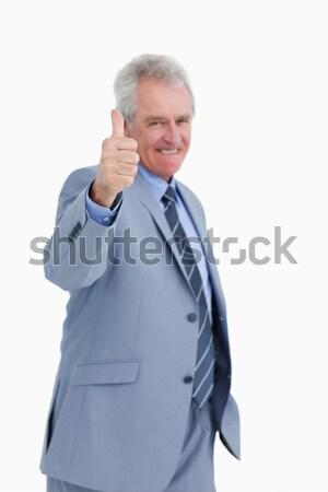 Dojrzały handlowiec kciuk w górę biały uśmiech Zdjęcia stock © wavebreak_media