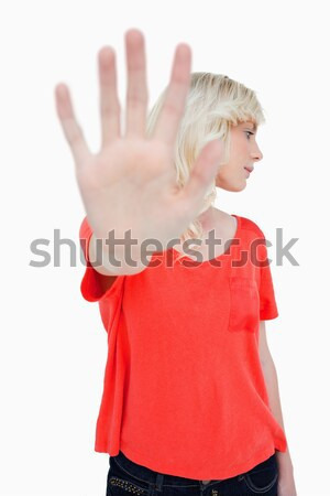 Stop hand gesture made by a young blonde woman against a white background Stock photo © wavebreak_media