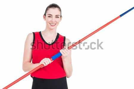 Red dumbbells being held by a young woman against a white background Stock photo © wavebreak_media