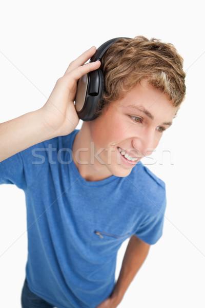 Halszem kilátás szőke férfi visel fejhallgató Stock fotó © wavebreak_media
