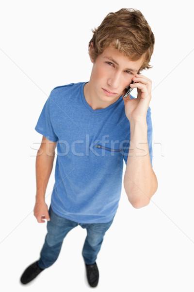 Fisheye jonge man roepen smartphone witte Stockfoto © wavebreak_media